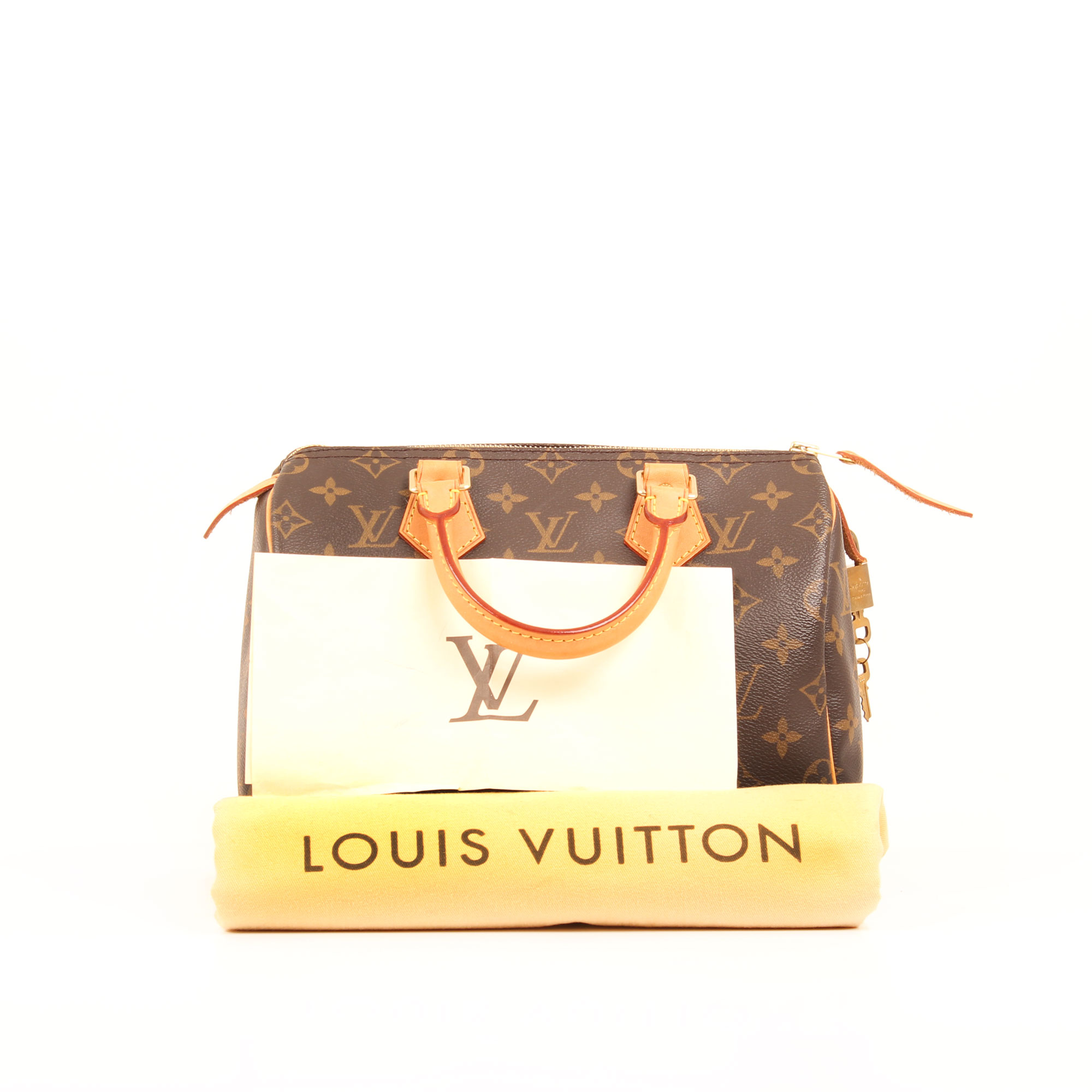 Imagen de los extras y dustbag del bolso louis vuitton speedy 25 monogram
