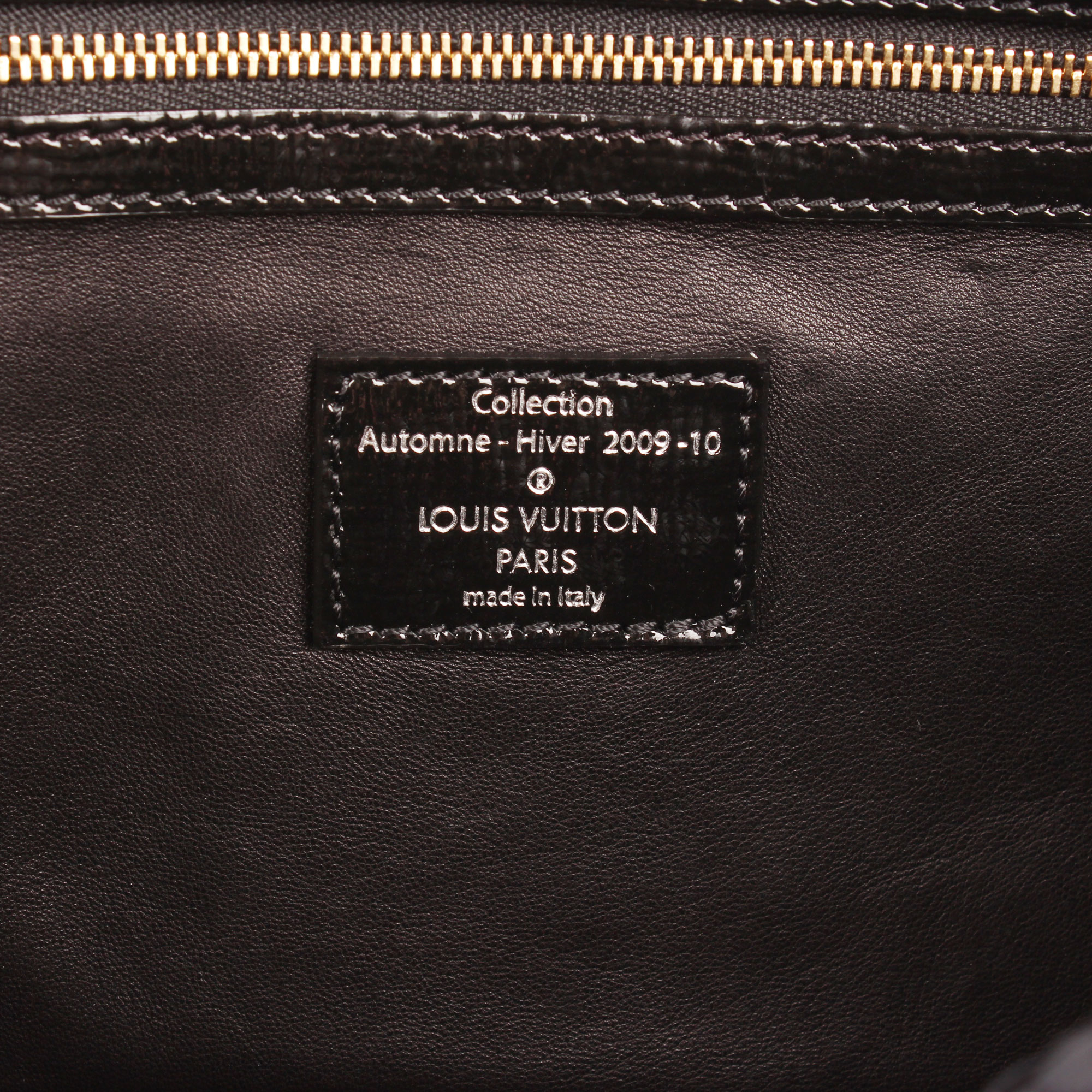 Interior tag of louis vuitton coquette embossed monogram navy blue fabric leather clutch bag