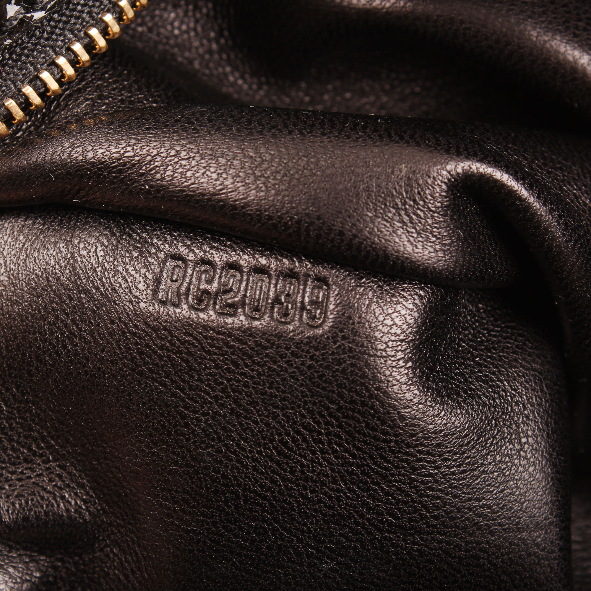 Image of serial number of louis vuitton coquette embossed monogram navy blue fabric leather clutch bag