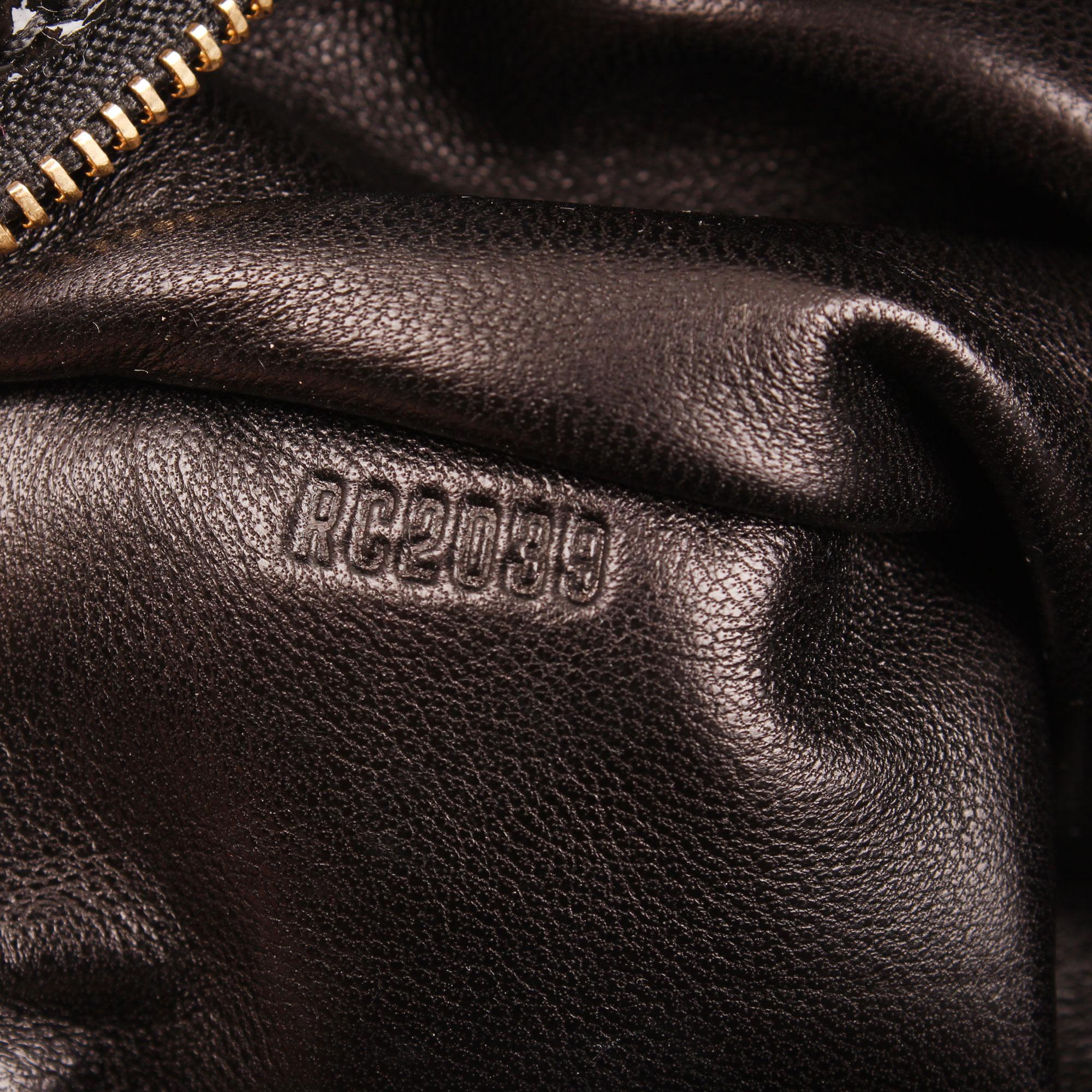 Imagen del numero de serie del louis vuitton coquette clutch embossed monogram azul marino tela piel