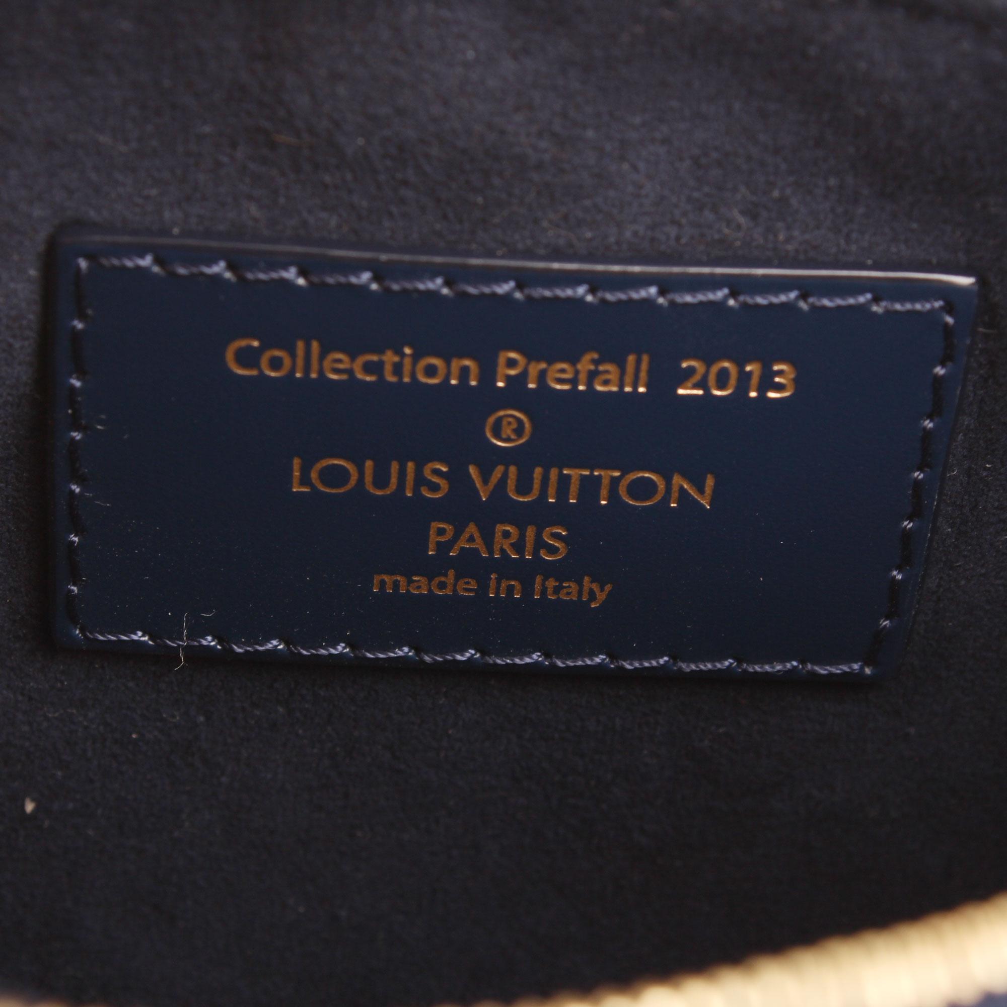 Imagen de la etiqueta interior de la pochette louis vuitton damier paillettes mini accessories