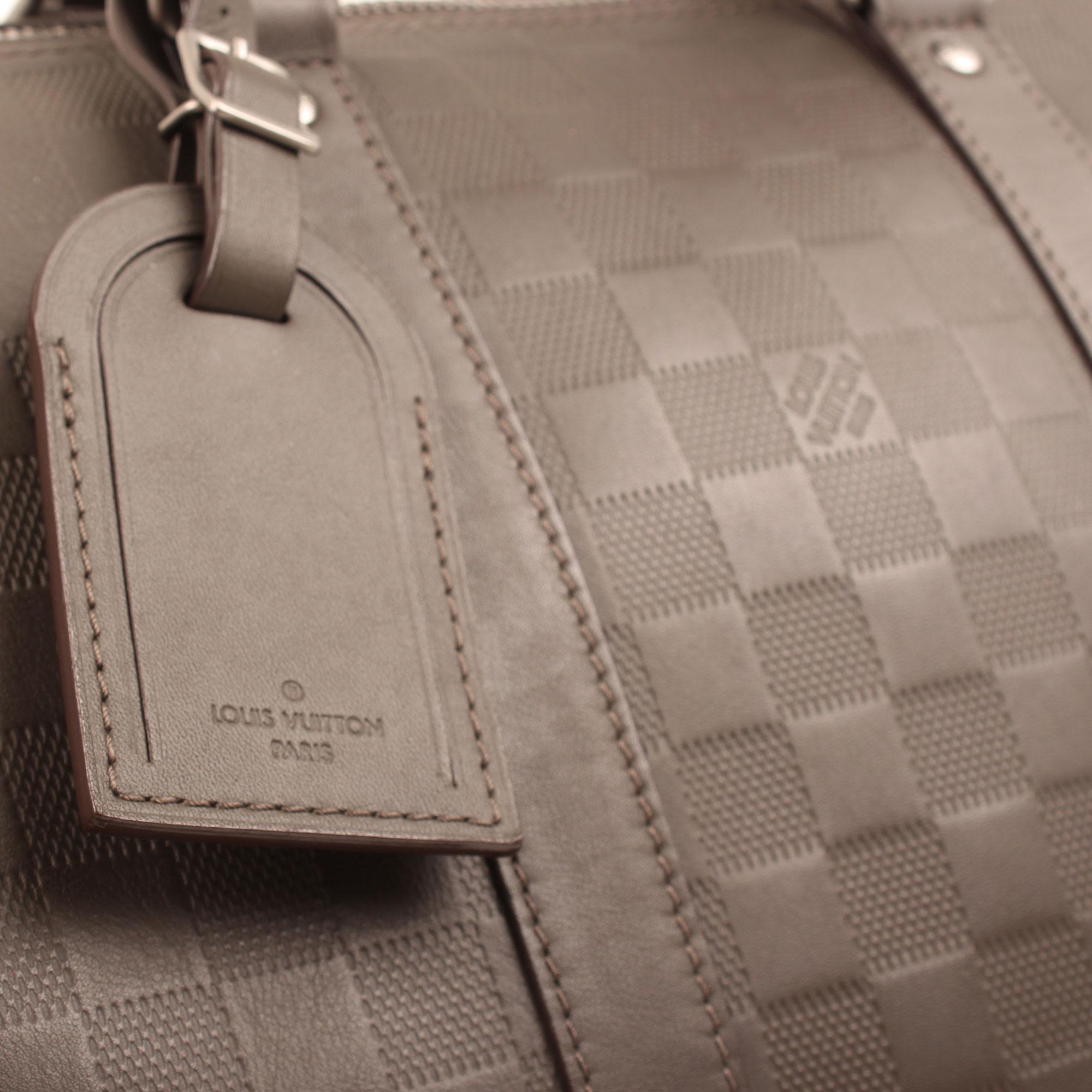 Imagen del identificador de la bolsa louis vuitton keepall 45 damier infini detalle general