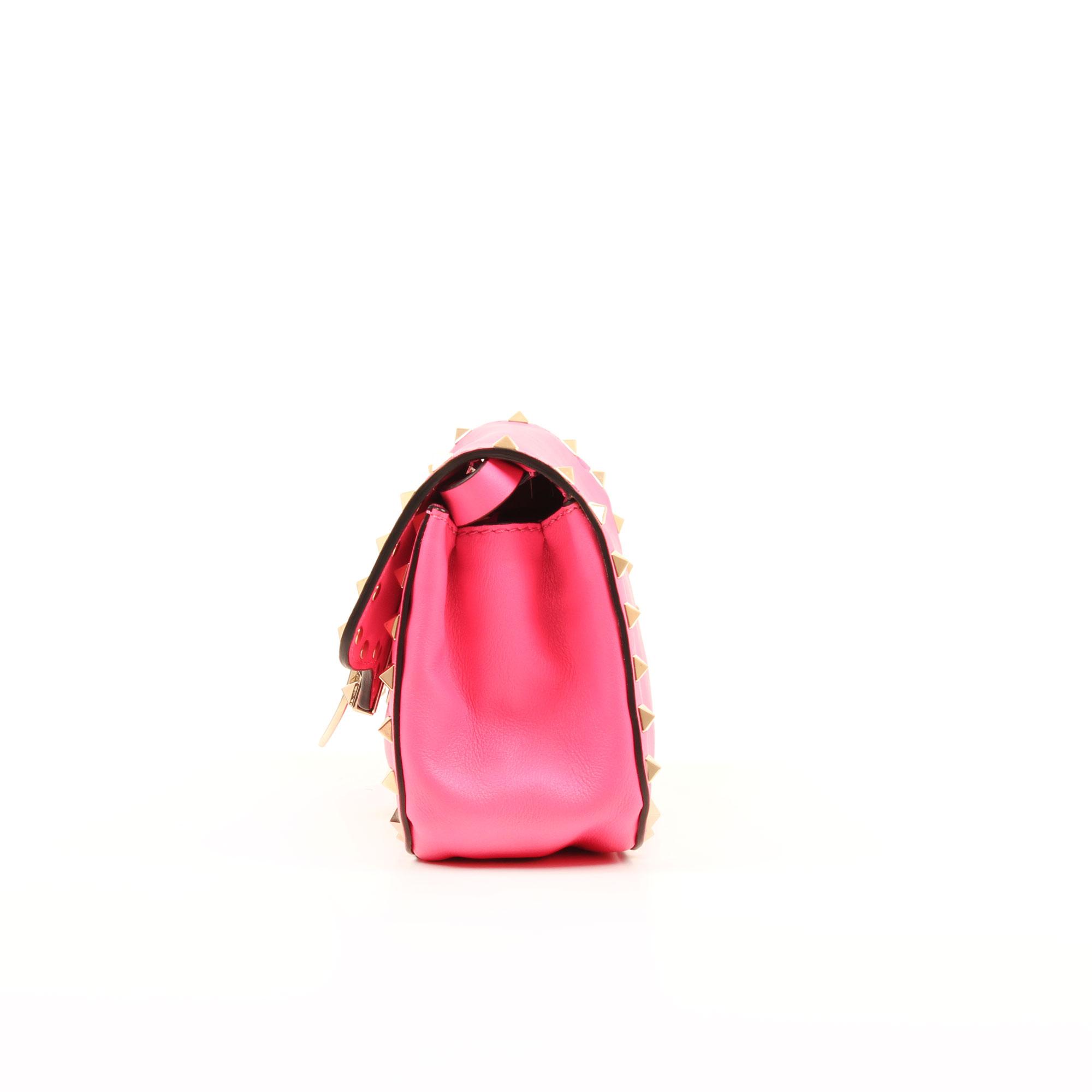 Side detail bag of valentino mini rockstud pink bag