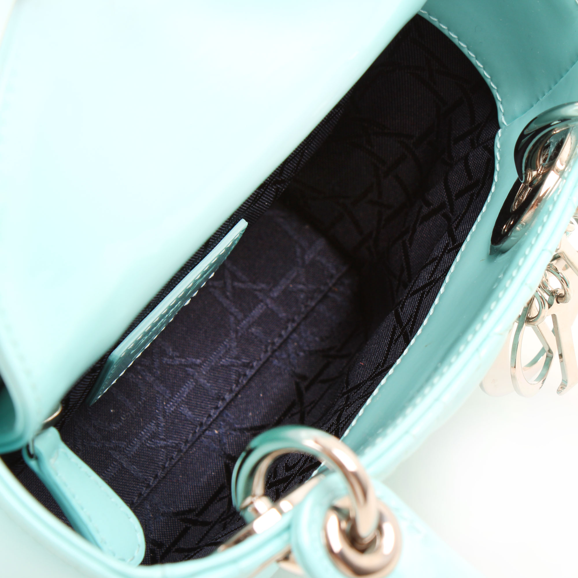 Interior image of dior mini lady dior bag patent blue leather