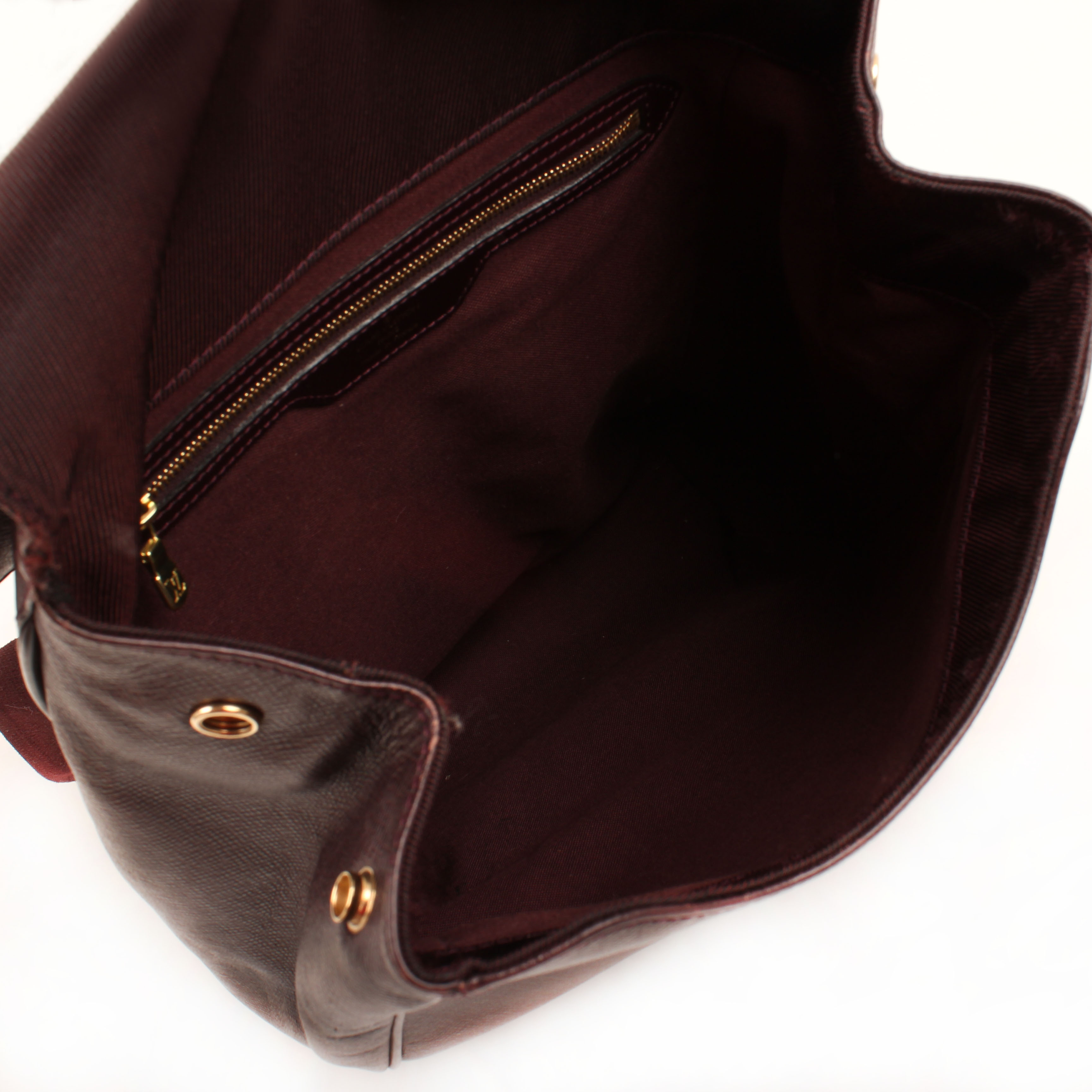 louis vuitton backpack cassiar taiga leather mahogany vintage interior