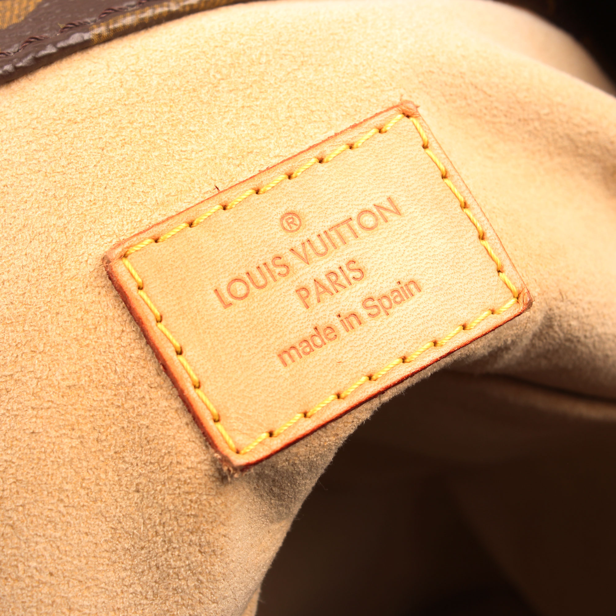 Imagen de la etiqueta del bolso louis vuitton artsy monogram mm etiqueta