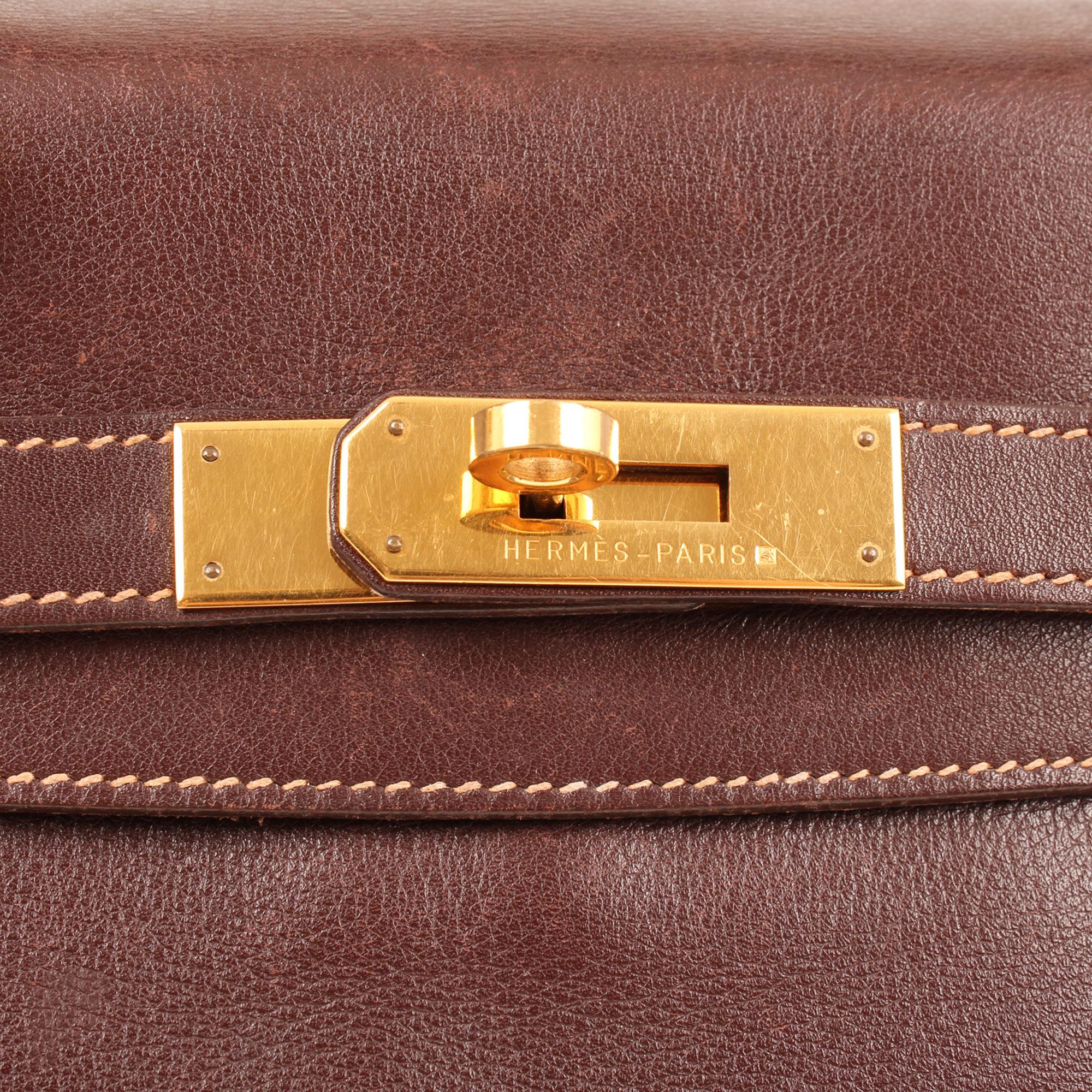 Imagen de la firma de la mochila hermes kelly a dos box calf terre