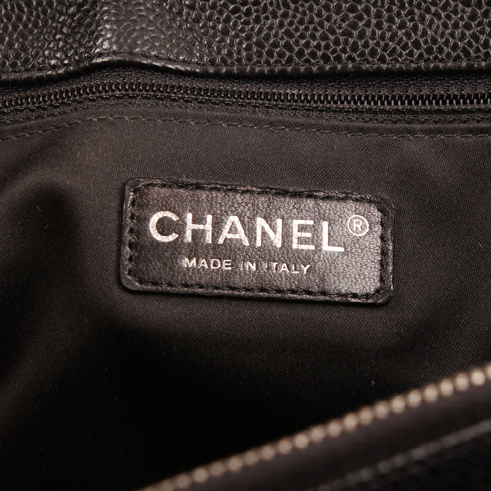 Interior tag image of chanel grand shopping tote bag black caviar leather
