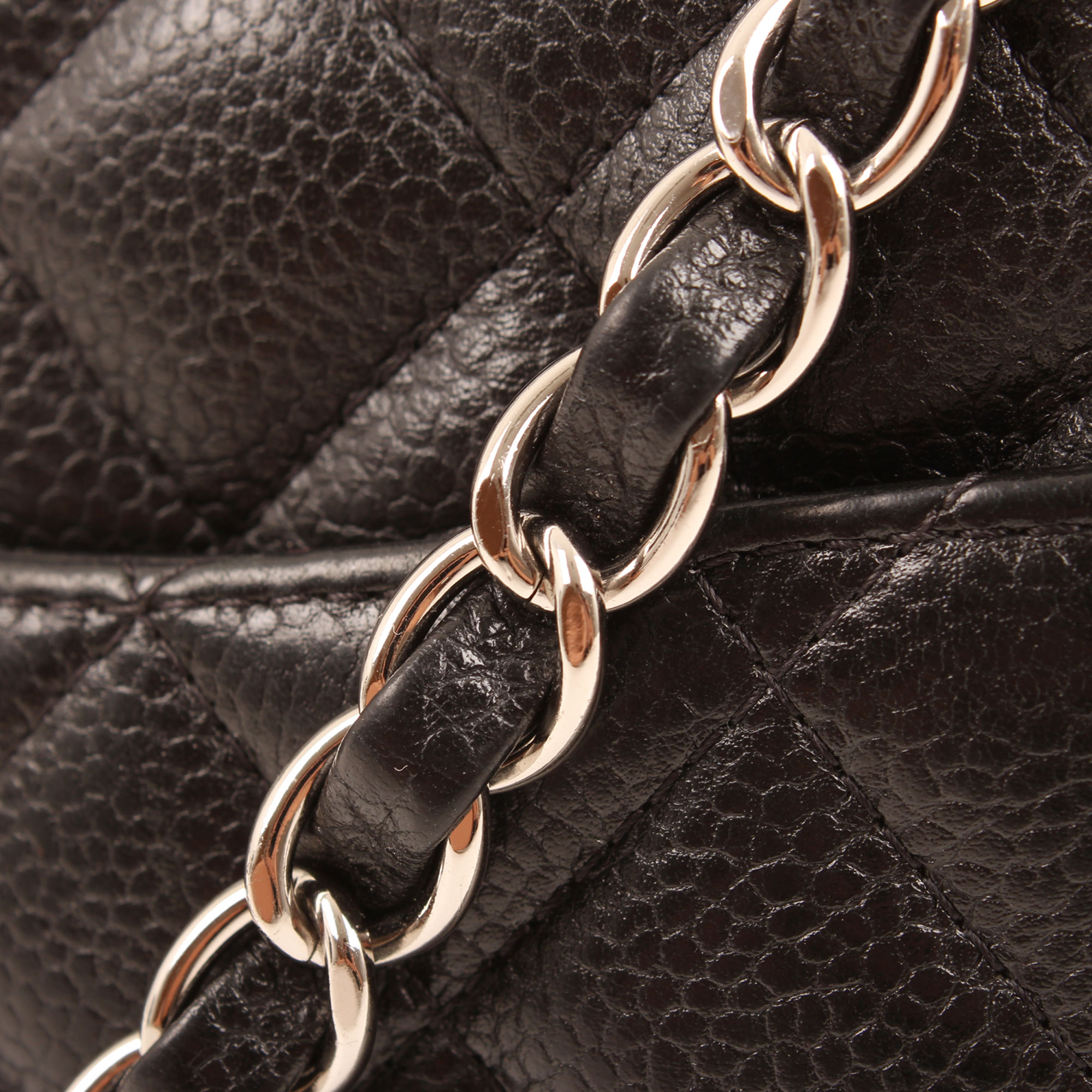 Chain detail image of chanel mini timeless black caviar leather chain