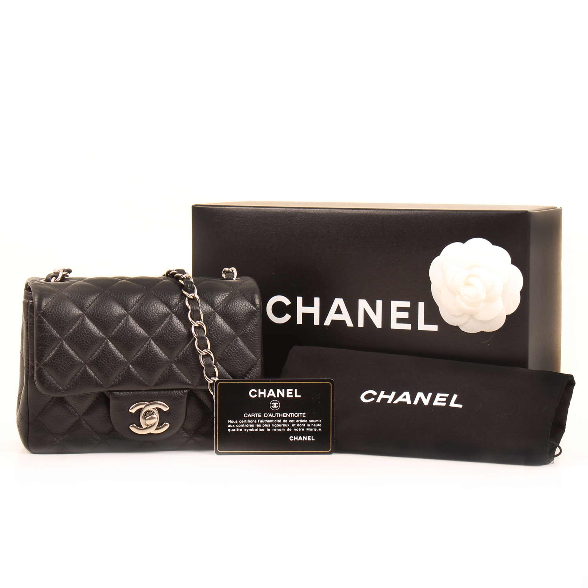 Image of the extras of chanel mini timeless black caviar leather