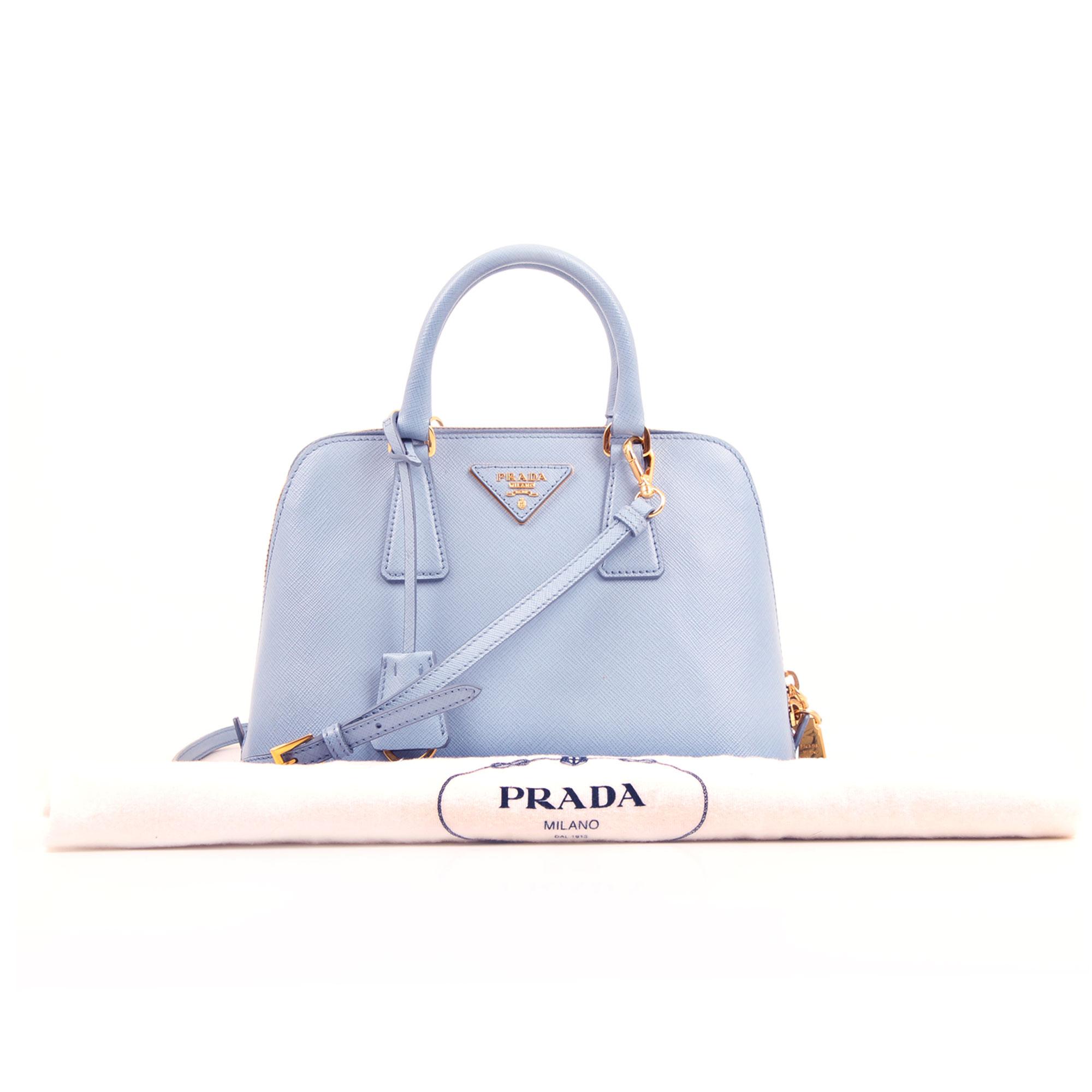 Imagen del dustbag del bolso prada small promenade saffiano azul