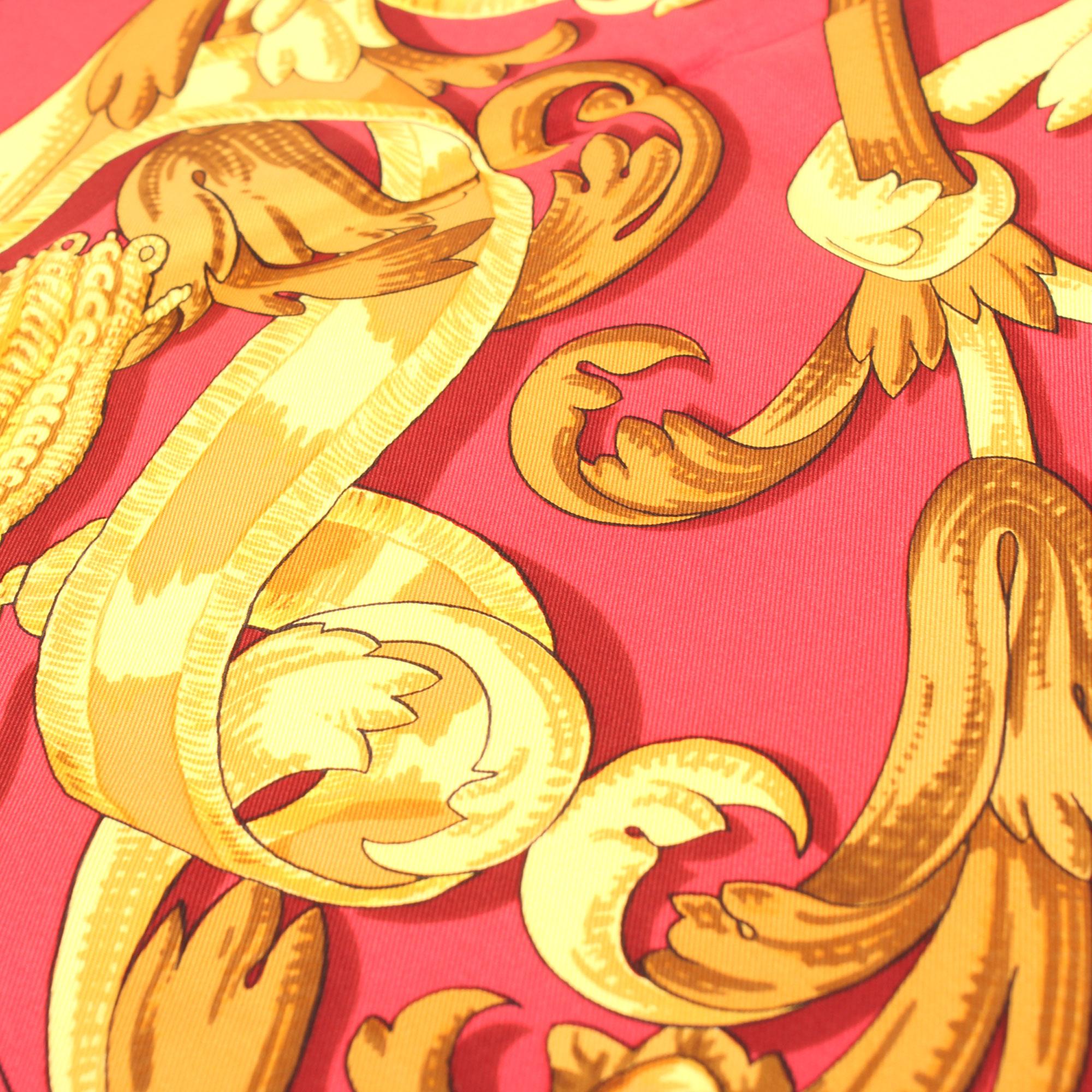Imagen de detalle del hermes carre le mors a la conetable rojo dorado