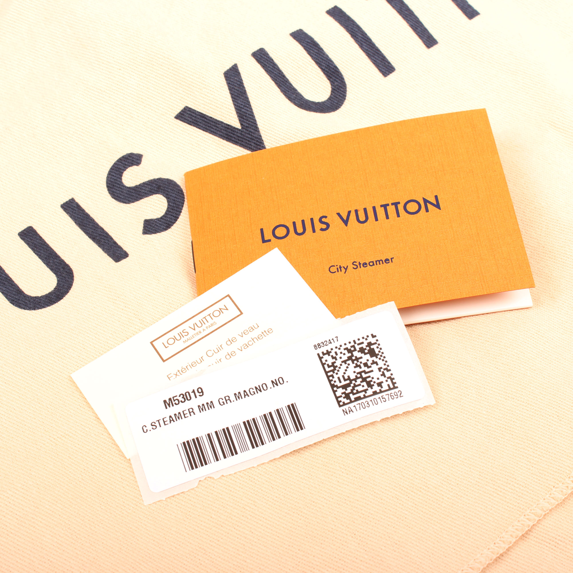 Imagen de las etiquetas del bolso louis vuitton city steamer mm magnolia