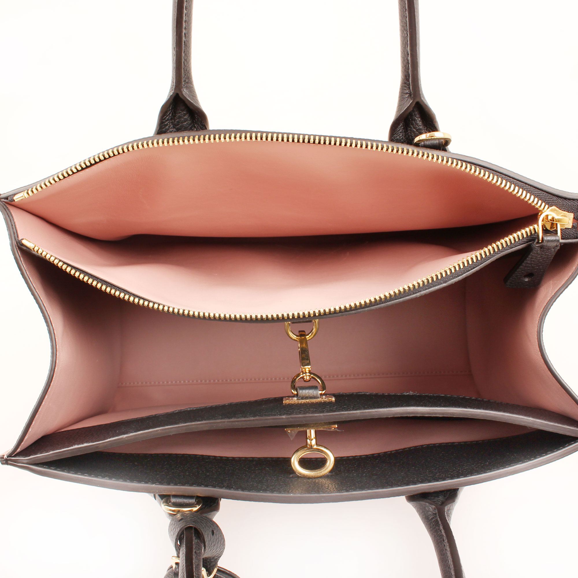 Imagen del interior del bolso louis vuitton city steamer mm magnolia
