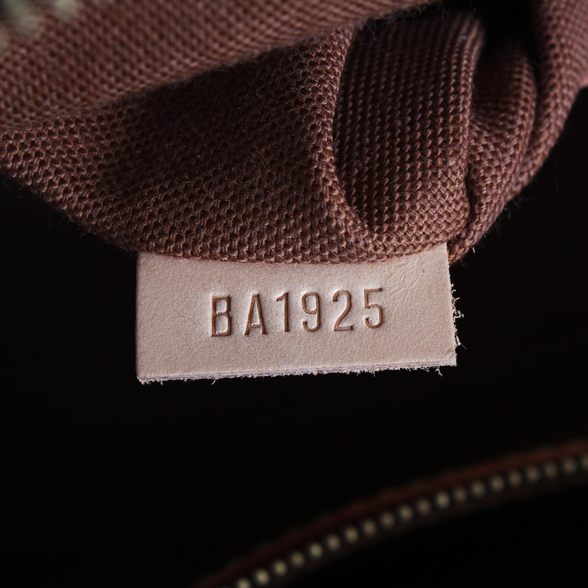 Imagen del numero de serie del bolso louis vuitton alma azzedine alaia