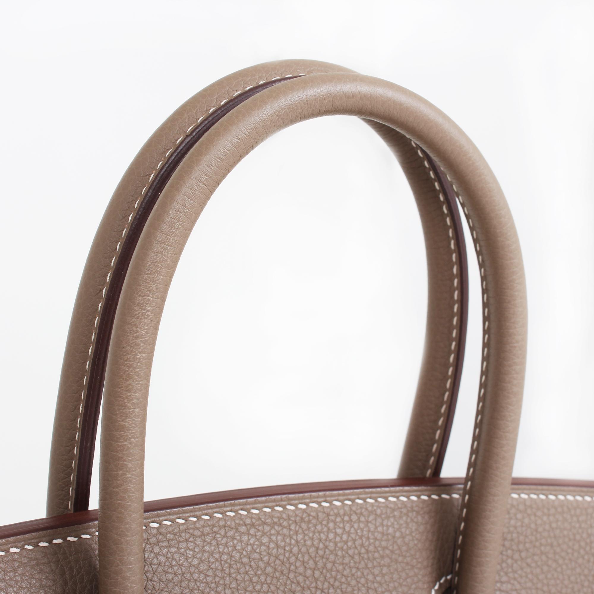 Image of the handle of hermes birkin bag taupe togo