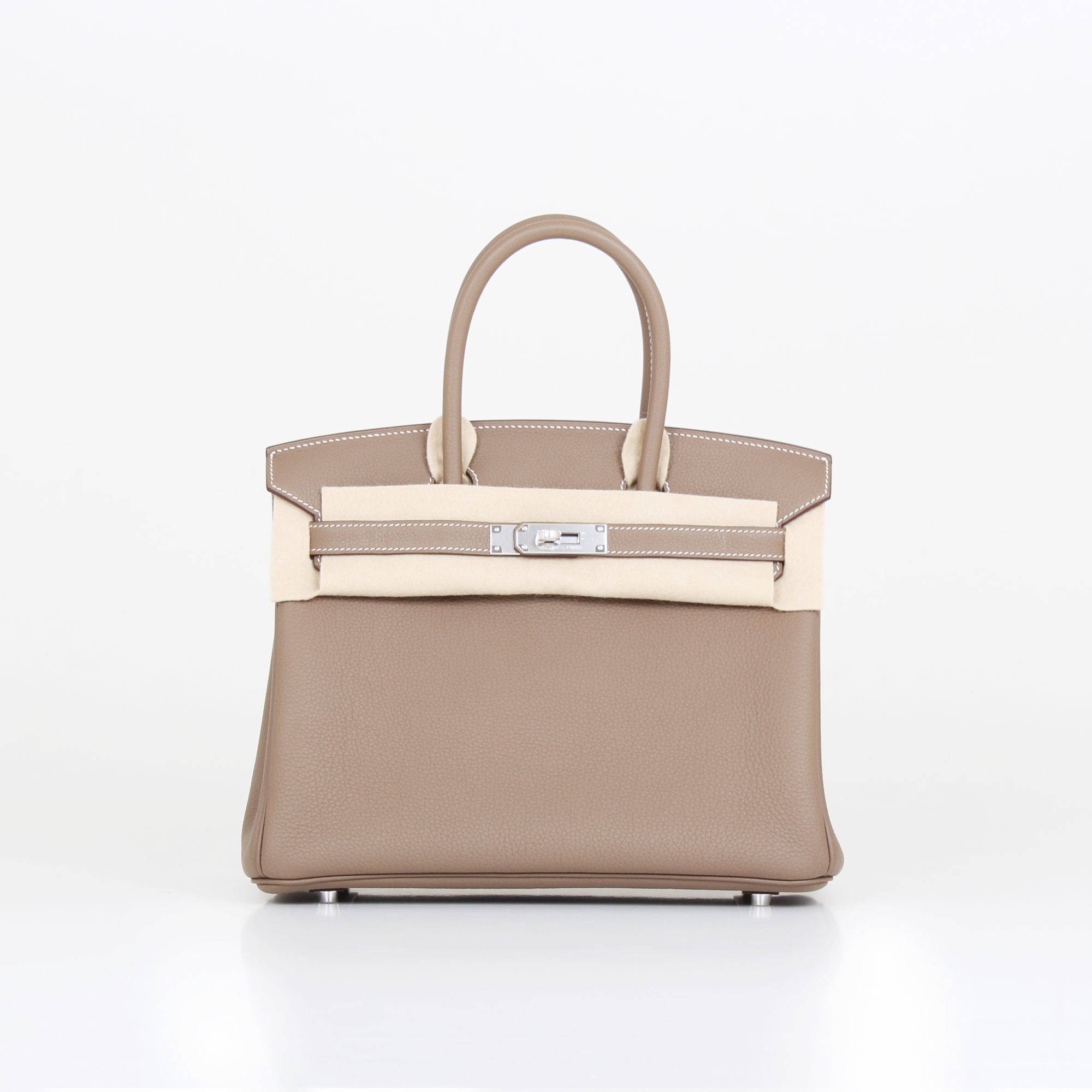 Front image of hermes birkin bag taupe togo with protective cloth
