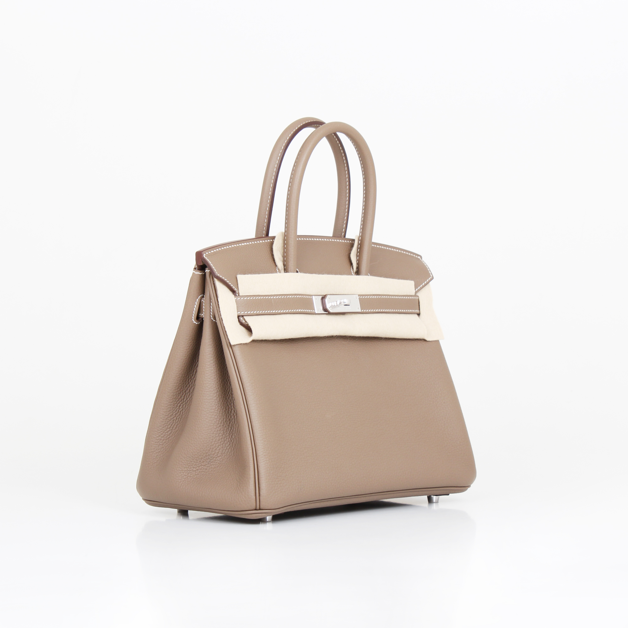 General image of hermes birkin bag taupe togo with protective cloth