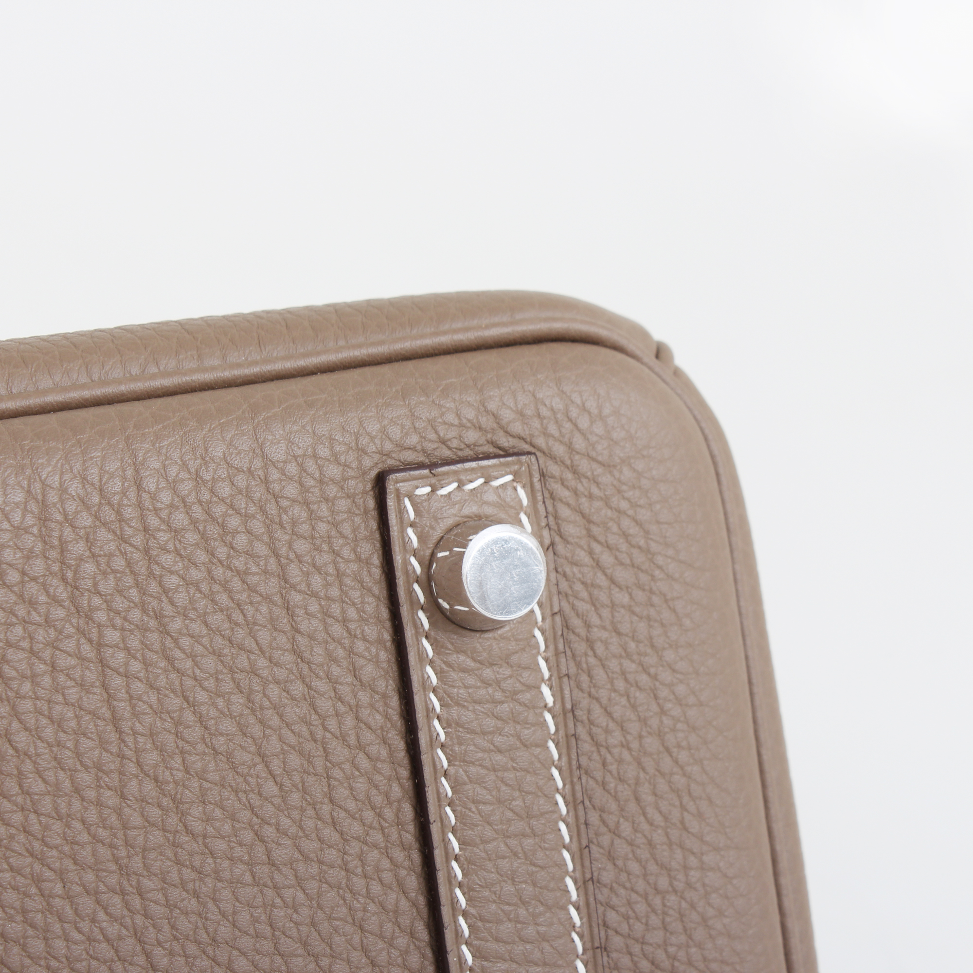 Image of the stud of hermes birkin bag taupe togo