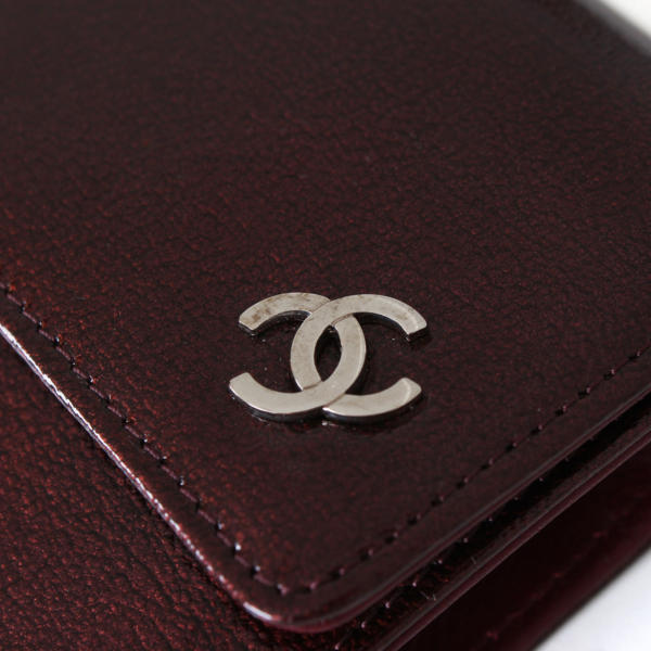 Chanel burgundy patent leather front flap wallet.